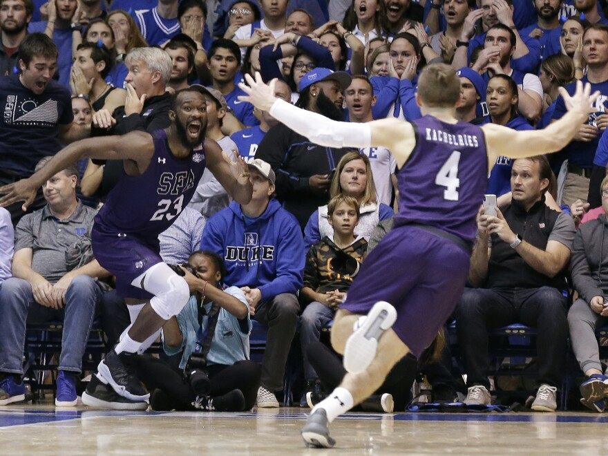 Stephen F. Austin forward Nathan Bain (23) and guard David Kachelries (4) celebrate Bain's game-winning shot against Duke in overtime Tuesday in Durham, N.C.