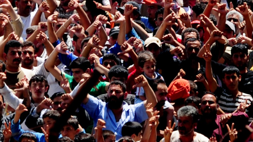 Syrian refugees gather for a protest against Syrian President Bashar al-Assad at the Turkish Red Crescent camp in the Yayladagi district of the Turkish city of Hatay, two kilometers from the Syrian border, on June 20, 2011.