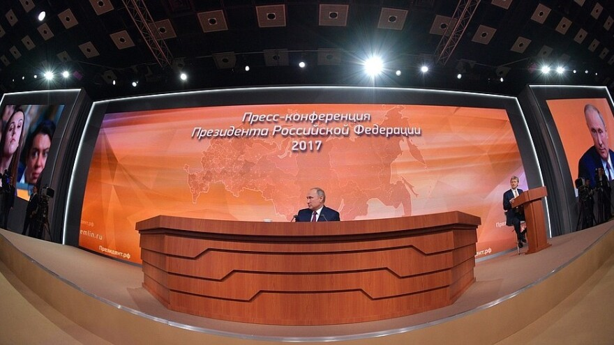 Russian President Vladimir Putin is seen at his annual news conference, in an image released by the Kremlin.