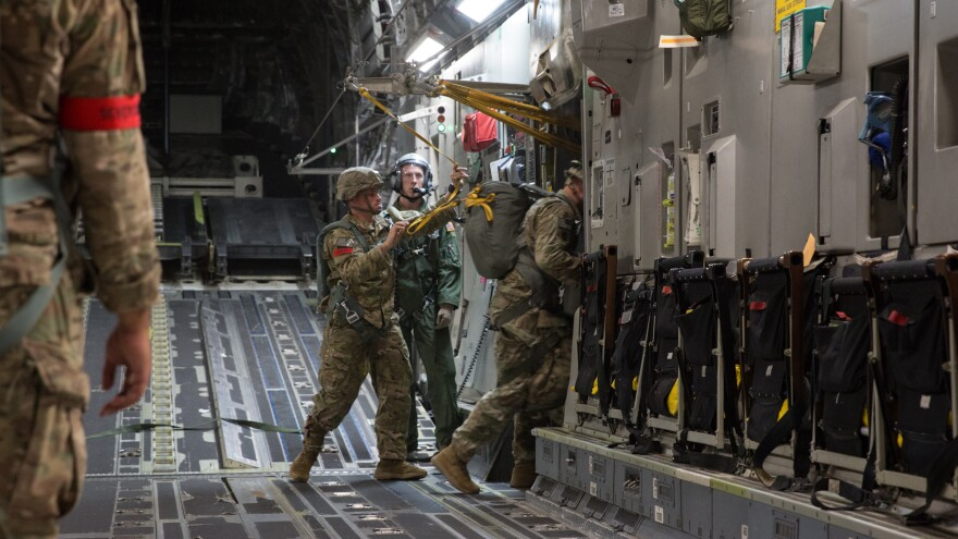 A paratrooper from the 82nd Airborne Division jumps out of a C-17 jet transport during a training jump last month at Fort Bragg, N.C.