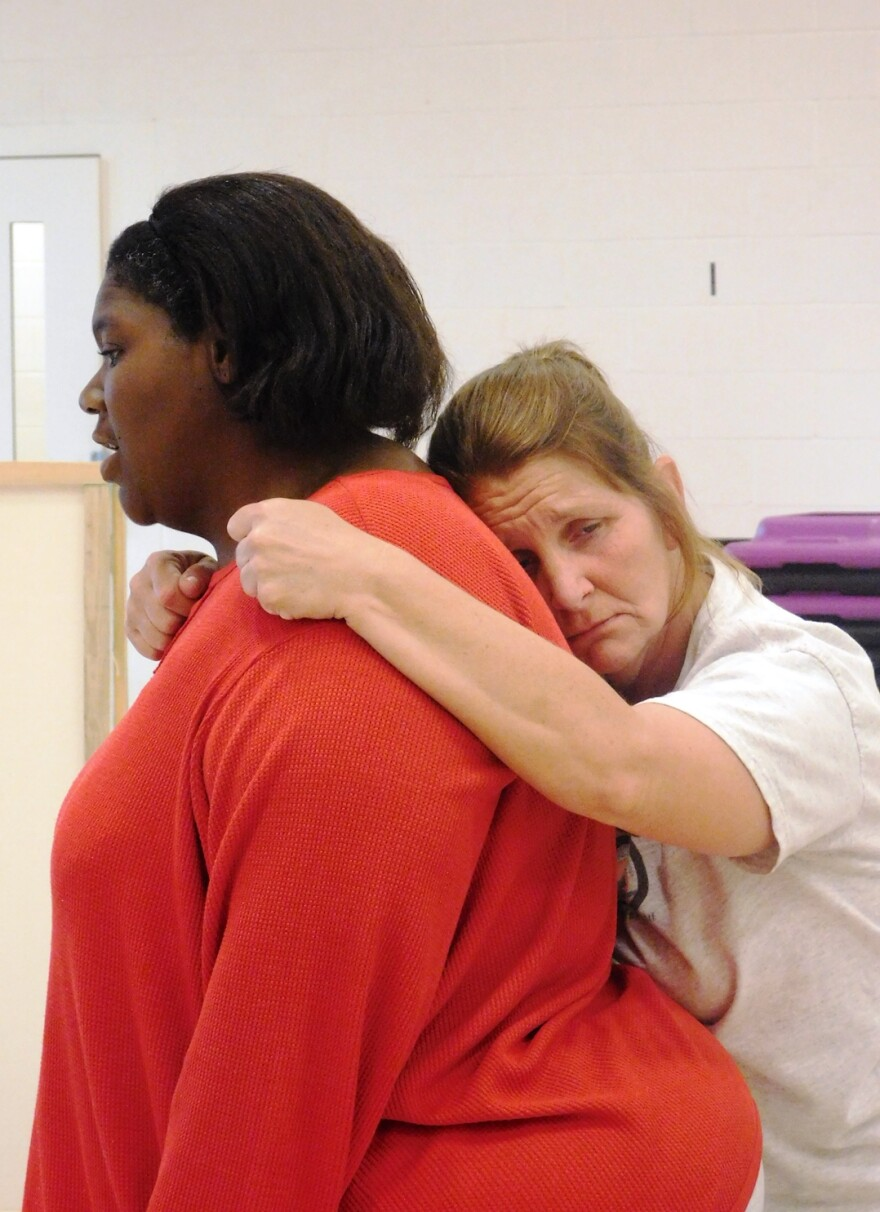 June 1, 2017 photo: Amy Sherrill (right) and LaWanda Jackson in Run-On Sentence share a touching moment in Run-On Sentence.