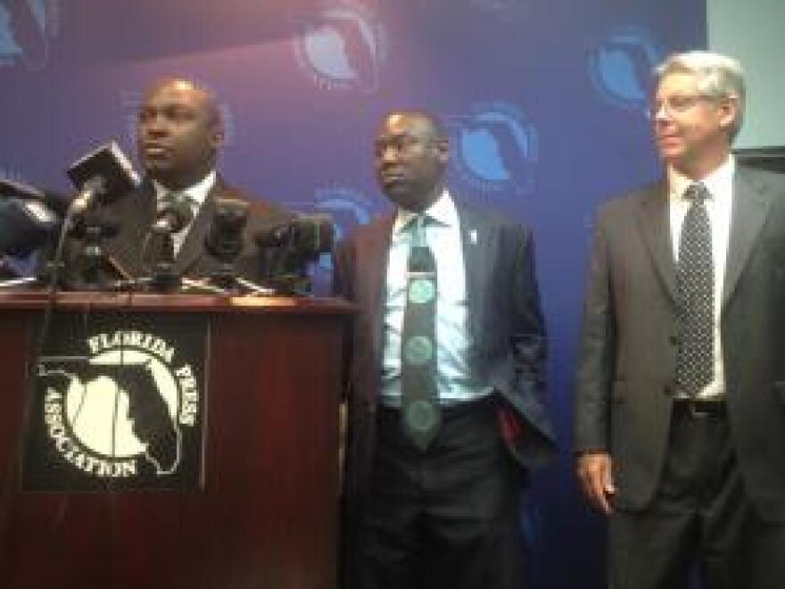 Tallahassee attorneys Daryl Parks (left) and Benjamin Crump (middle) joined by former DOC employee George Mallinckrodt (right) during a press conference Monday.