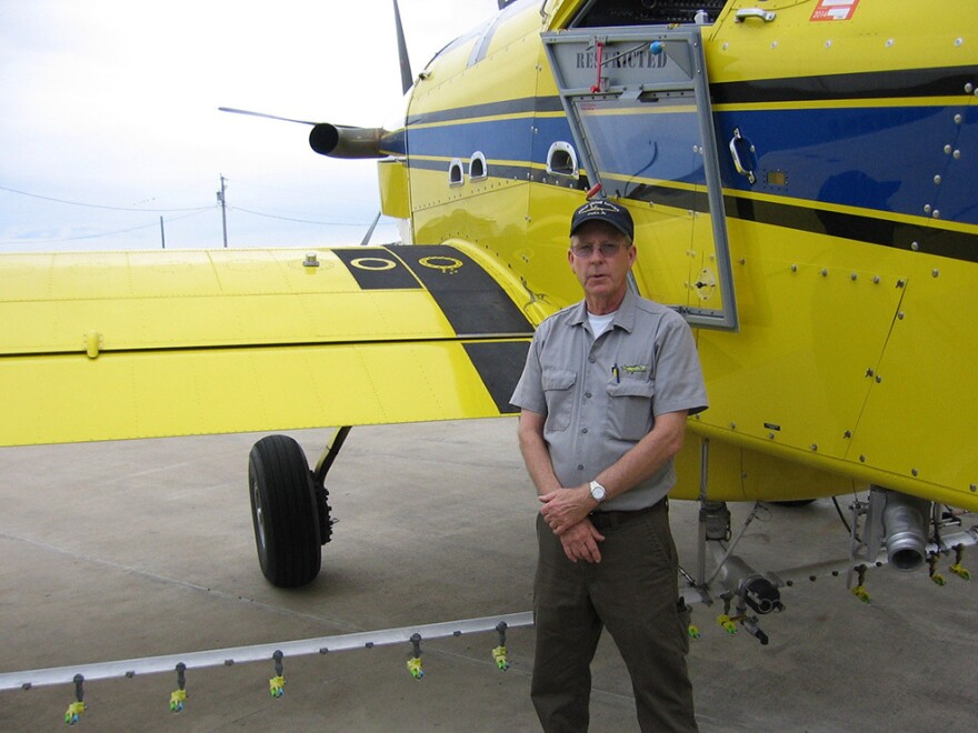 "Missouri pilot Mike Lee stands next to a crop-duster. ""I know some people who have had accidents. I've had friends that got killed in these things,"" he says."