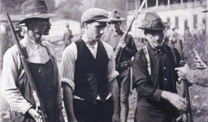 Miners from Battle of Blair Mountain giving up their guns after Federal troops arrived on Sept 2