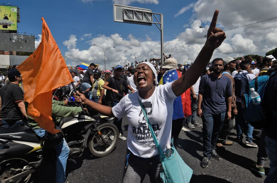 Opposition activists at the march in Caracas. Venezuela's economy is in freefall; inflation is rampant, lootings and riots are common, and blackouts are frequent.