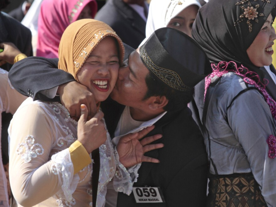 A man kisses his bride during a mass wedding in Jakarta, Indonesia in April.