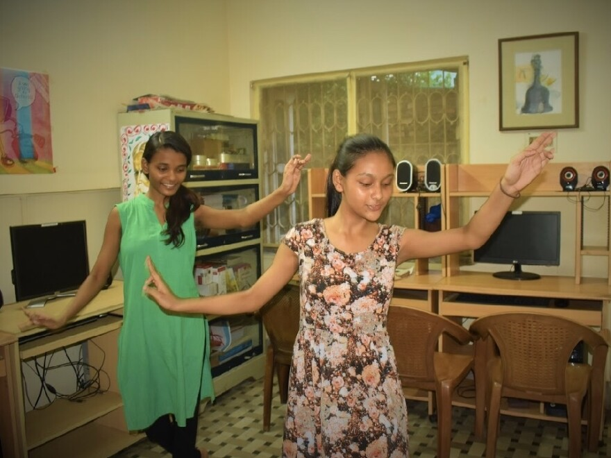 "Shibani, left, and Madhabi, who live at the New Light residential home for children of sex workers, practice an Indian dance called ""B-fusion."""