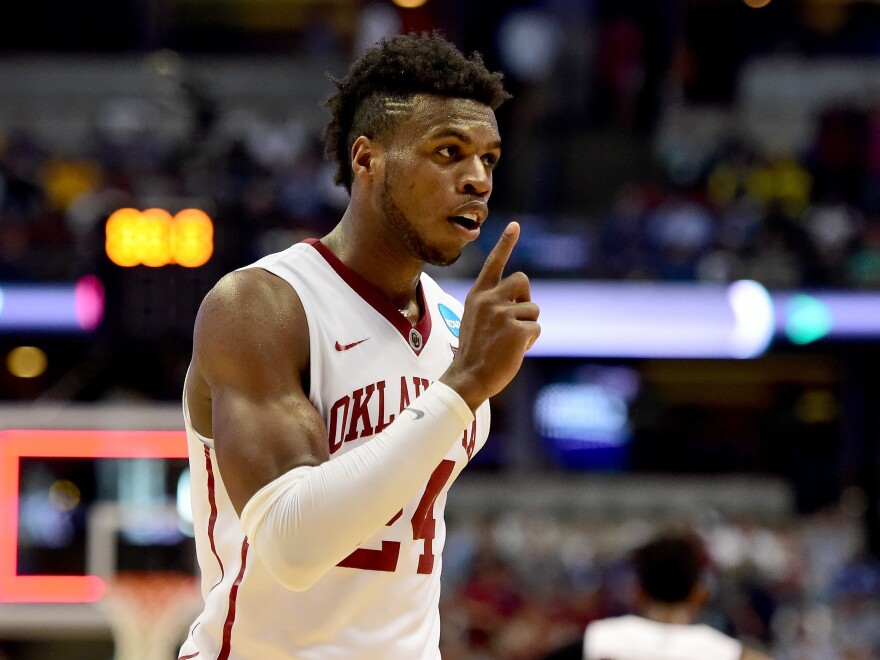 Oklahoma's Buddy Hield celebrates the Sooners' 77-63 win over Texas A&M in the third round of the NCAA tournament.