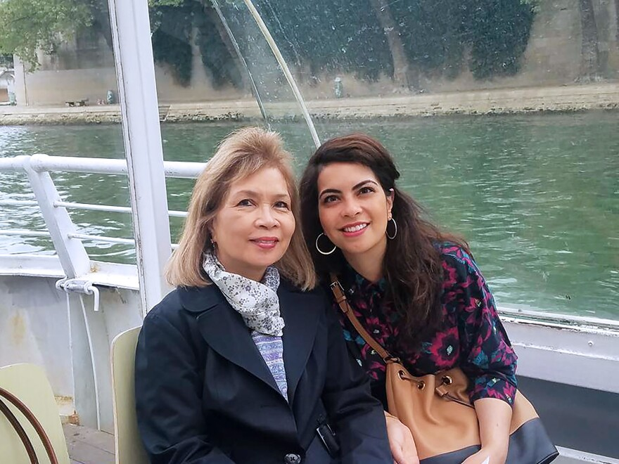 The author Malaka Gharib and her mother Fleurdeliz San Pedro on a family trip to Paris in April.