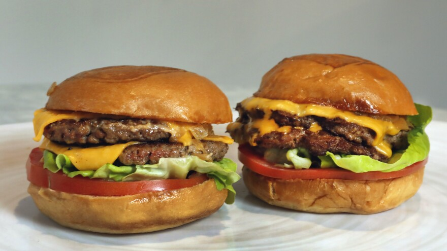 An Impossible Burger, left, and a Cali Burger, from Umami Burger. A new era of meat alternatives appeared on restaurant menus and grocery story shelves in 2019.