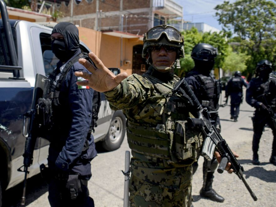 Mexican navy members and federal police take part in an operation in Acapulco in the state of Guerrero, Mexico, on Tuesday to disarm local police.