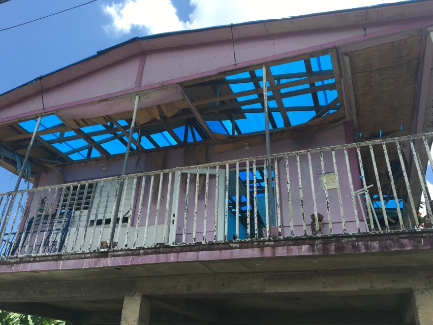 Rafaela Serrano's house in the municipality of Caguas is still roofless eight months after Hurricane Maria. Countless homes on the island remain damaged two weeks before the start of the next hurricane season.