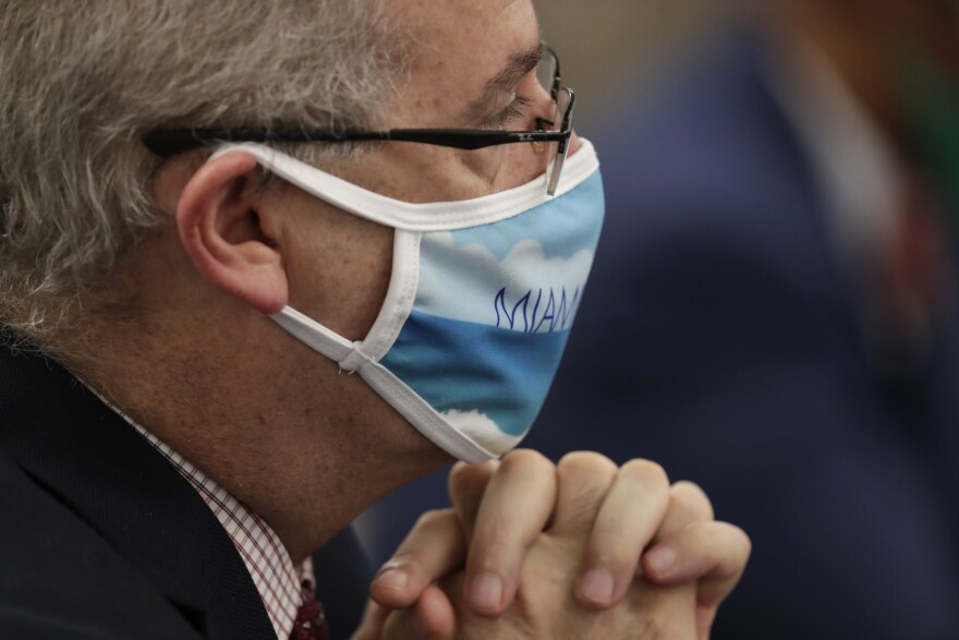Miami Beach Mayor Dan Gelber listens during a roundtable discussion with Florida Gov. Ron DeSantis and Miami-Dade County mayors during the coronavirus pandemic, Tuesday, July 14, 2020, in Miami. (AP Photo/Lynne Sladky)
