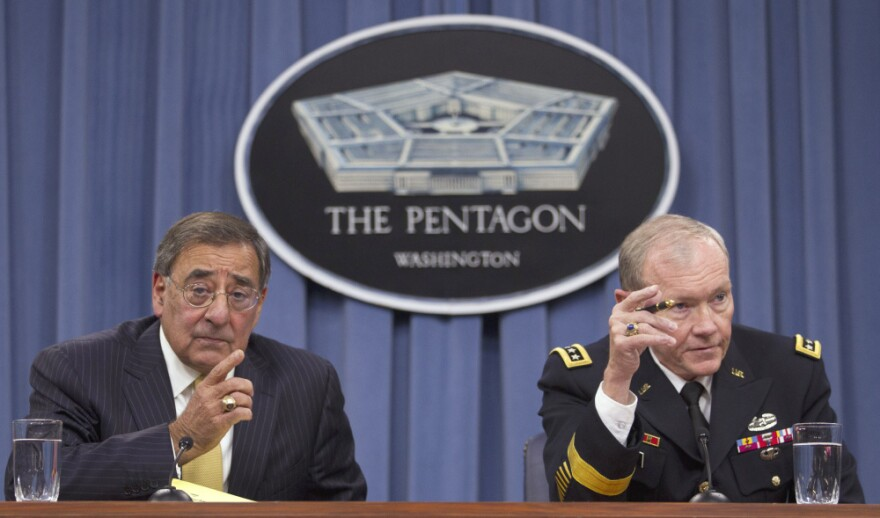 Defense Secretary Leon Panetta and Joint Chiefs Chairman Gen. Martin Dempsey take part in a news conference at the Pentagon. The Pentagon has said certain cuts in defense spending would endanger national security, invite aggression and devastate Defense Department operations.