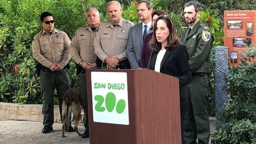 City Attorney Mara Elliott at the San Diego Zoo, where she announced ivory trafficking charges against a local gallery. She is surrounded by officers from the state Department of Fish and Wildlife.