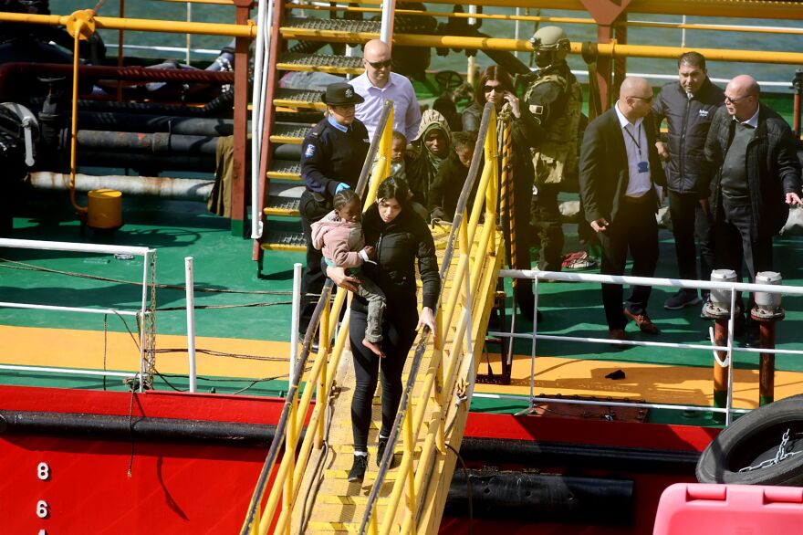 Migrants disembark from the motor tanker El Hiblu 1 in Valletta's Grand Harbour after Maltese armed forces took control of the vessel on Thursday.