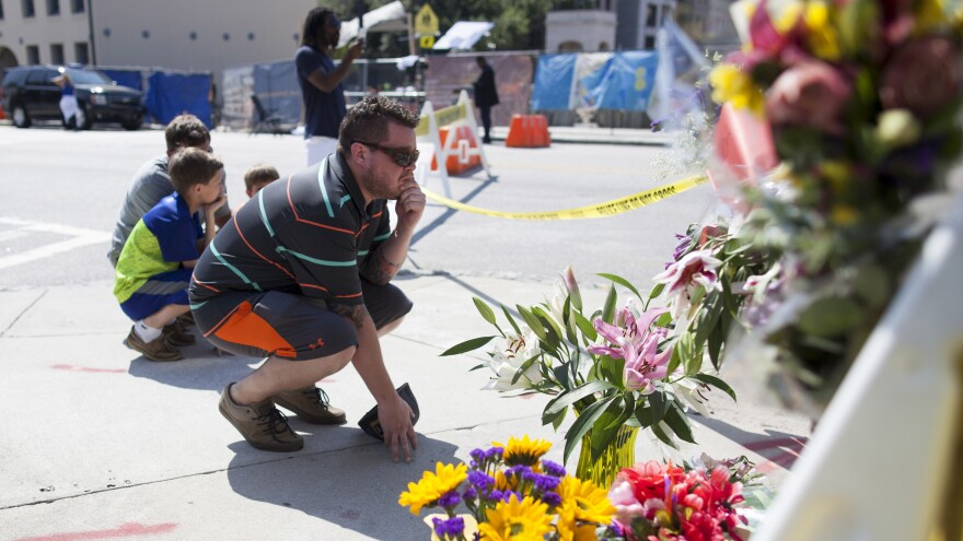 Charleston residents visit a makeshift memorial for victims of Wednesday's mass shooting at the Emanuel AME Church on Calhoun Steet in Charleston, S.C.