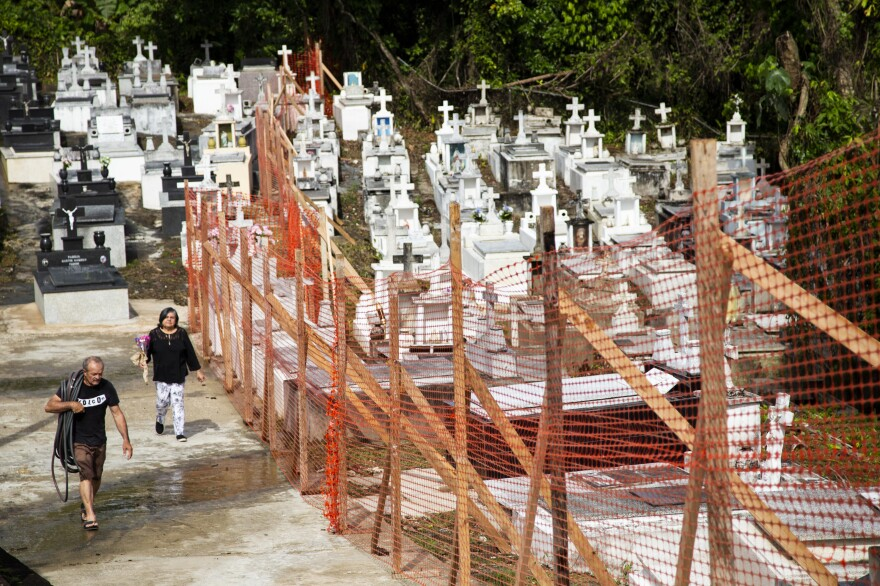 Before opening for Mother's Day, officials installed a plastic fence to keep people out the cemetery's most damaged areas. A landslide during Hurricane Maria destroyed nearly 1,800 tombs in the cemetery.