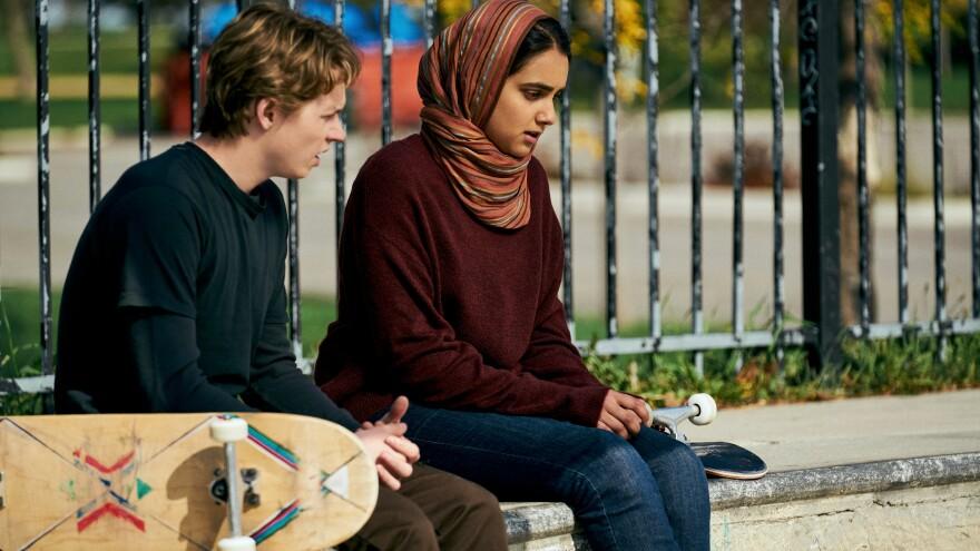 Hala (Geraldine Viswanathan) keeps her relationship with Jesse (Jack Kilmer) a secret in <em>Hala</em>, now streaming on Apple TV+.