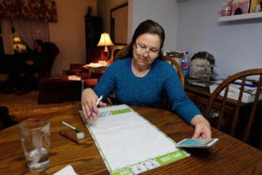 Brenda Davis carefully schedules all of the 3 teenage boys' appointments on a calendar.