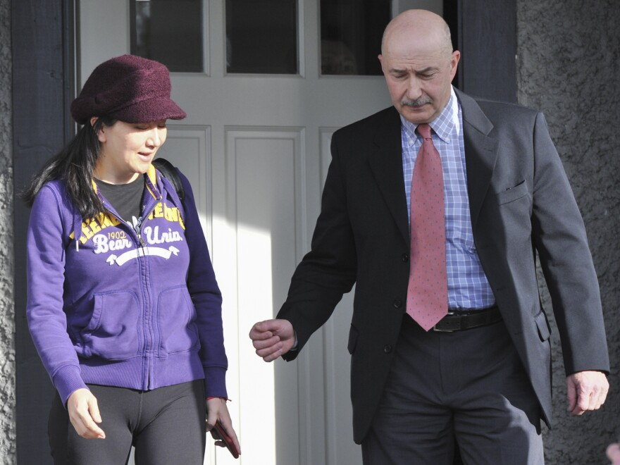 Huawei Chief Financial Officer Meng Wanzhou leaves her Vancouver home with security detail to appear in British Columbia Supreme Court, in Vancouver, on March 6.