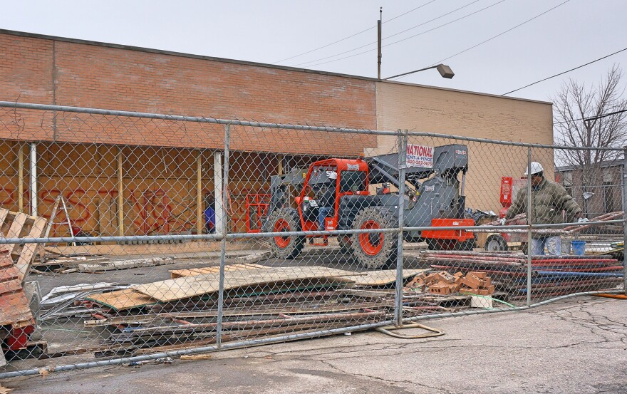 GoceryLane's structure and exterior are almost completely repaired, but workers at the site say that the inside still has a long way to go before the Old North Dayton grocery reopens.
