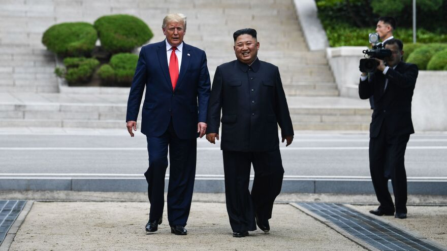 North Korean leader Kim Jong Un walks with President Trump north of the military demarcation line that divides North and South Korea, in the Joint Security Area of Panmunjom in the Demilitarized Zone, on Sunday.