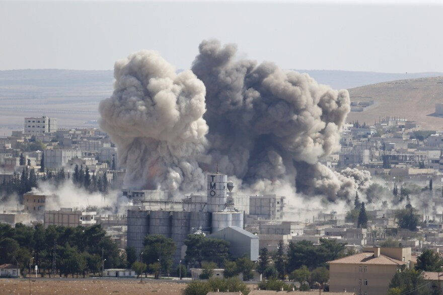 Smoke rises after a U.S.-led airstrike in the Syrian town of Kobani on Wednesday. The Kurdish border town has been fiercely contested in a three-week assault.