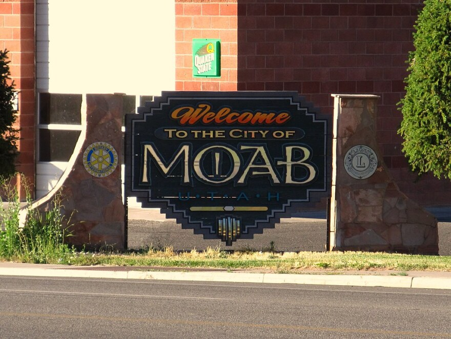 Photo of a sign welcoming people to the city of Moab.