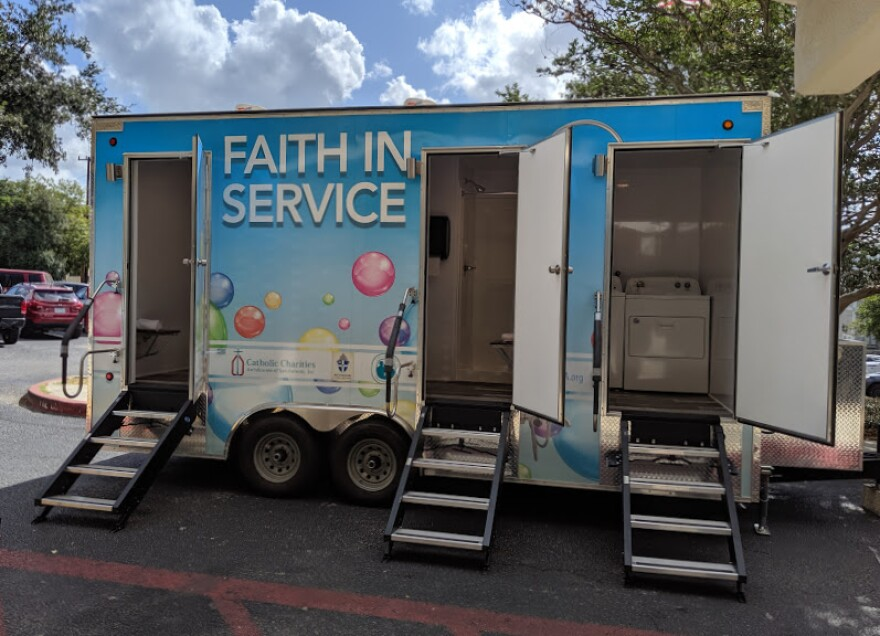 A mobile unit with showers, toilets, sinks and one laundry room with a full washer and dryer.