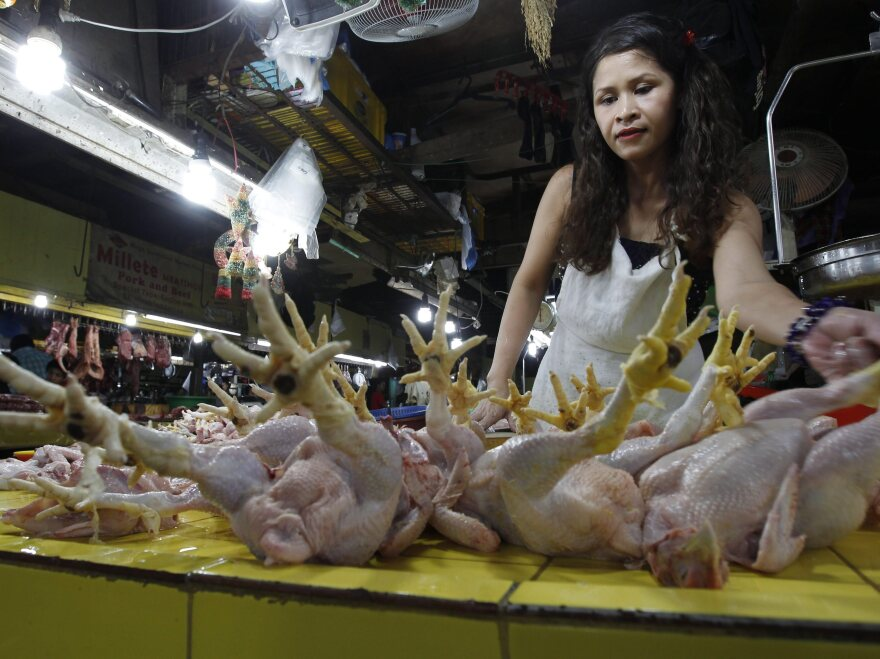A Filipino chicken vendor in Quezon City, east of Manila, Philippines. Researchers say Pacific island chicken are genetically similar to the variety found in the Philippines, but different from South American chicken.