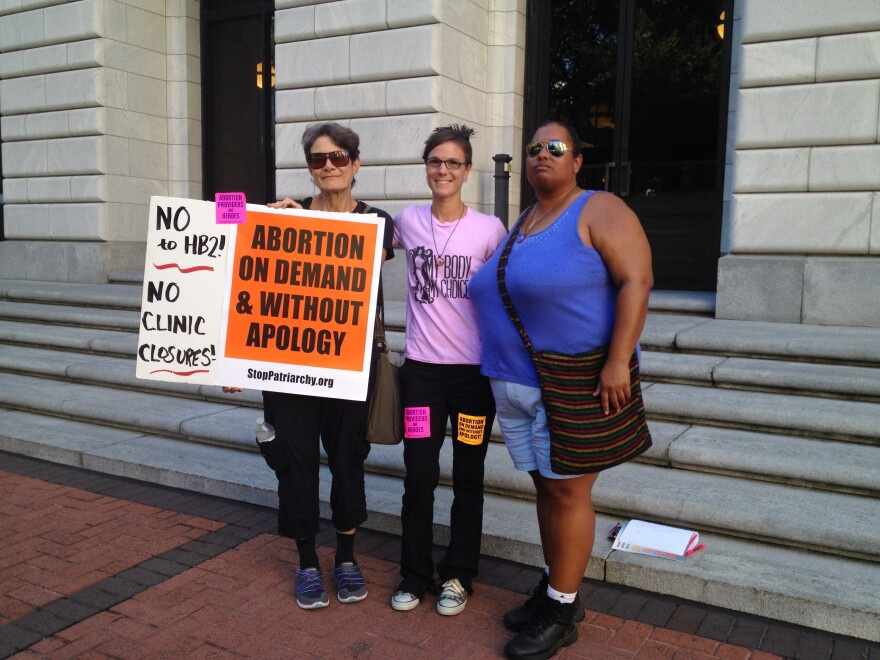 Sandy Jones (from left) of Houston, with Amelie Hahn and Michelle Colon, of Mississippi. Hahn and Colon are with Pink House Defenders, a group fighting for the last remaining abortion clinic in Mississippi.