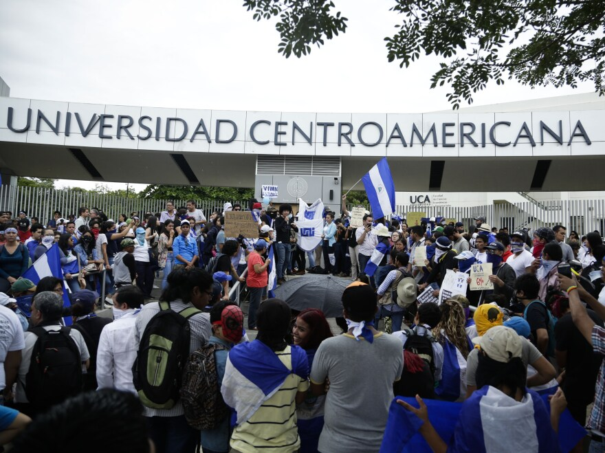 Demonstrators gather during a protest outside the Jesuit-run Central American University in Managua, Nicaragua.