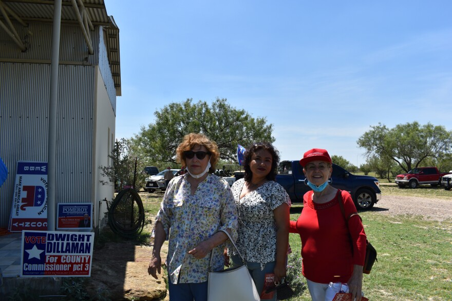 Sylvia Cervantes (right) poses for a picture with other Latinas at Webb County Republican Party meeting in late August.