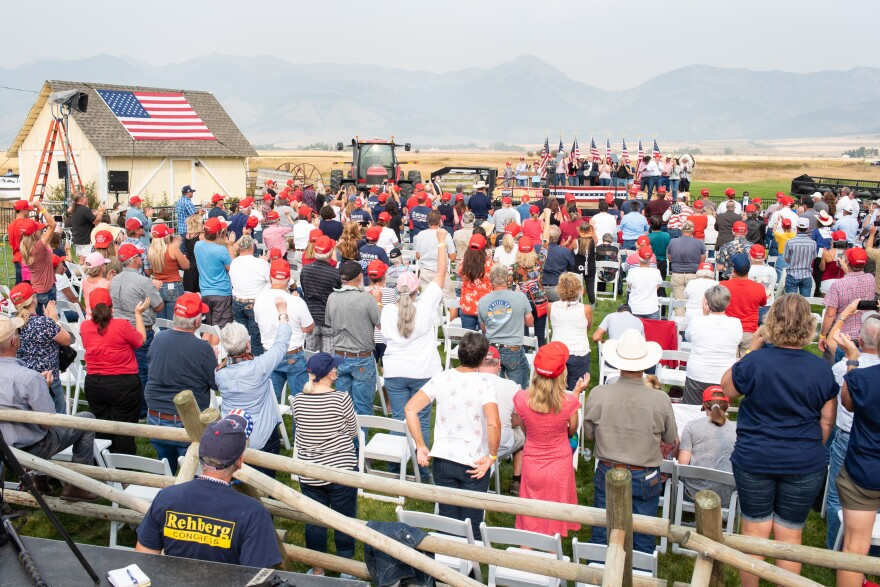 A crowd of people stand to applaud speakers at a Montana Republican Party event for federal and statewide office seakers.