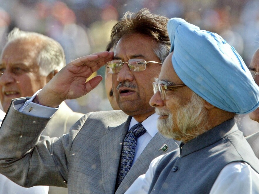 In 2005, Pakistan's President Gen. Pervez Musharraf salutes spectators as Indian Prime Minister Manmohan Singh (right) looks on during a cricket match between India and Pakistan in New Delhi. The two leaders later held talks on how to end decades-old hostilities.
