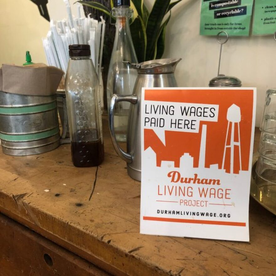 A sign in a East Durham Bake Shop advertises it pays a living wage