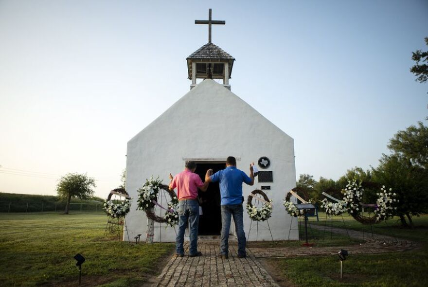 Residents hold a vigil at La Lomita Chapel in Mission