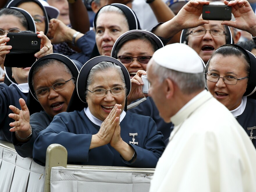 """Nuns greet Pope Francis as he arrives to lead the weekly audience in Saint Peter's Square at the Vatican on Thursday. The pope, speaking at his weekly general audience, said sometimes separation is """"morally necessary."""""""