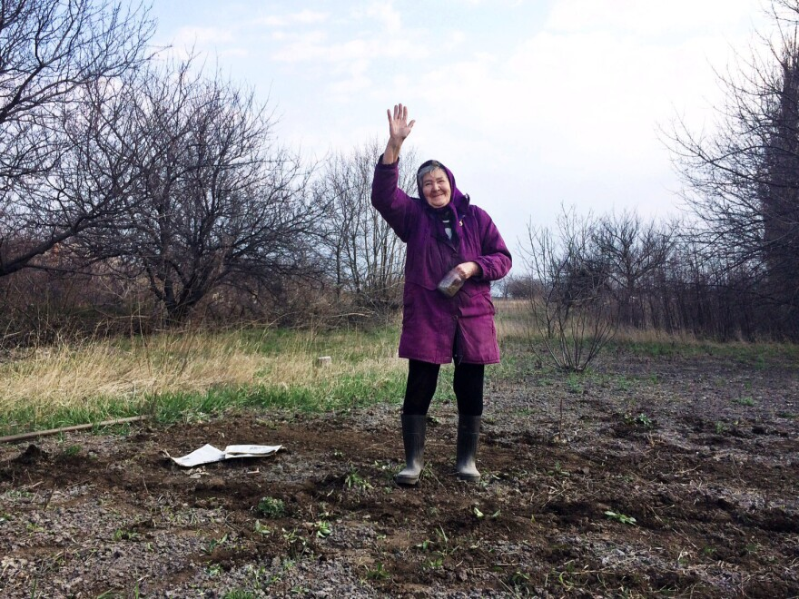 """In the rundown Ukrainian town of Perewalsk, near the Russian border, 80-year-old Lida Vasilivna has just planted a garden. """"Business just went belly up,"""" she says about her town's hard times, after asking, """"Are you gonna put this granny on TV?"""""""
