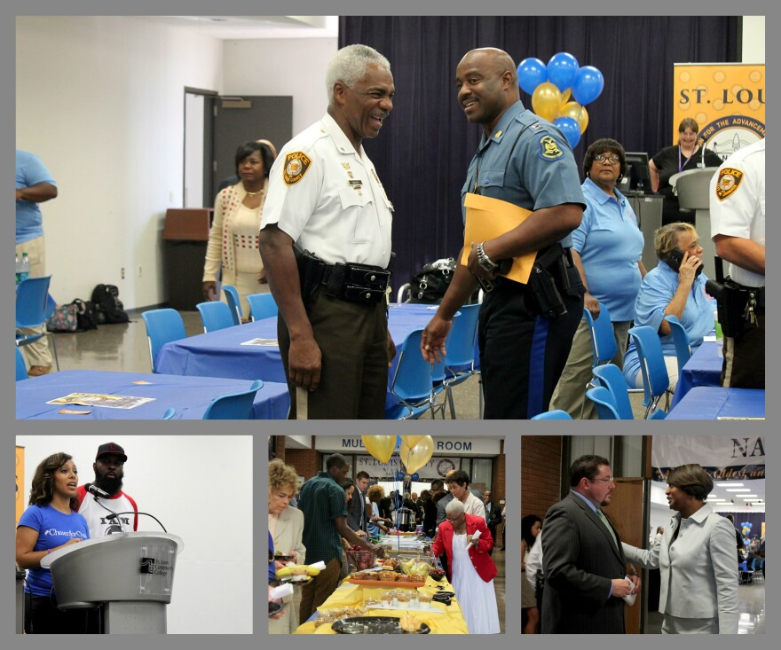 St. Louis County Lt. Col. Ken Gregory talks to Highway Patrol Capt. Ron Johnson. Ferguson Mayor James Knowles (bottom right) and Michael Brown Sr. (bottom left) along with many area leaders attended a St. Louis County NAACP brunch Friday, Aug. 7, 2015.