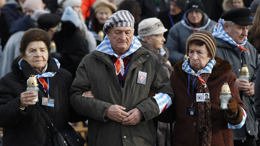 Survivors of Auschwitz at the former concentration camp Sunday.