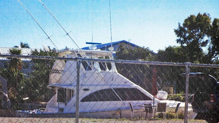 The boat, docked behind Michael Dewitt's home on Little Torch Key, was offered for $111 a night.