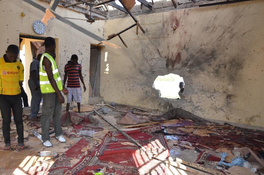 People inspect a damaged mosque following an October 2015 explosion in Maiduguri, Nigeria. Maiduguri is in Borno State, where Boko Haram was born.