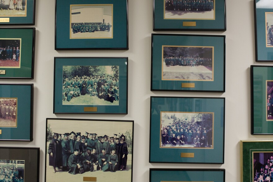 Old Tacoma Program graduation photos hang at Evergreen State College's Tacoma, Wash., campus. Maxine Mimms started the program in 1972.