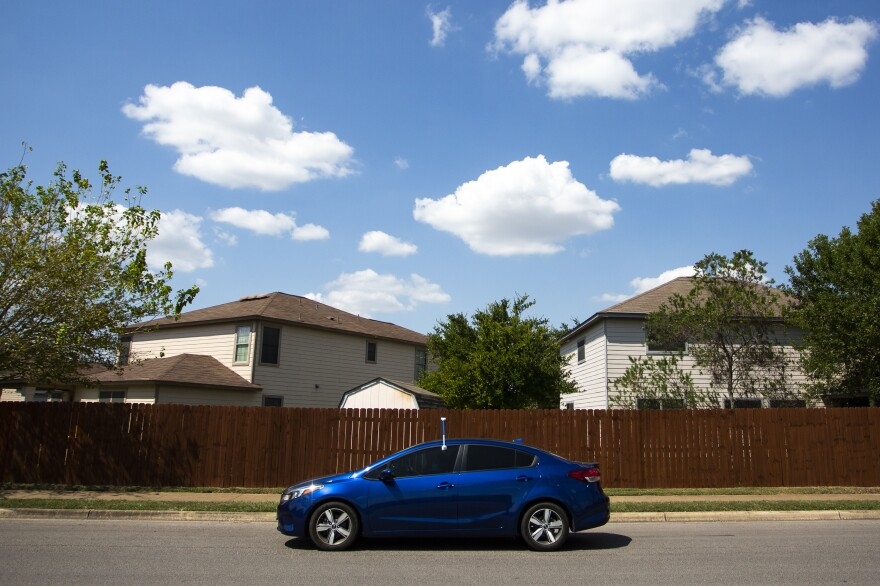 Frances Acuña drives through southeast Austin with a sensor attached to her driver's side door. It's part of a federal study to measure rising urban heat.