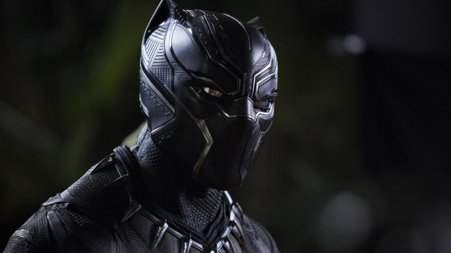 """The triangular patterns visible in Chadwick Boseman's Black Panther suit reflect what costume designer Ruth Carter calls """"the sacred geometry of Africa."""""""