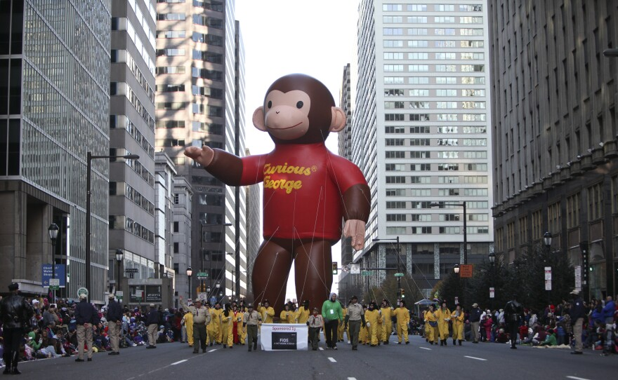 The Curious George balloon makes its way through Philadelphia during the 2011 Thanksgiving Day parade. Curious George is now a multimillion-dollar franchise.
