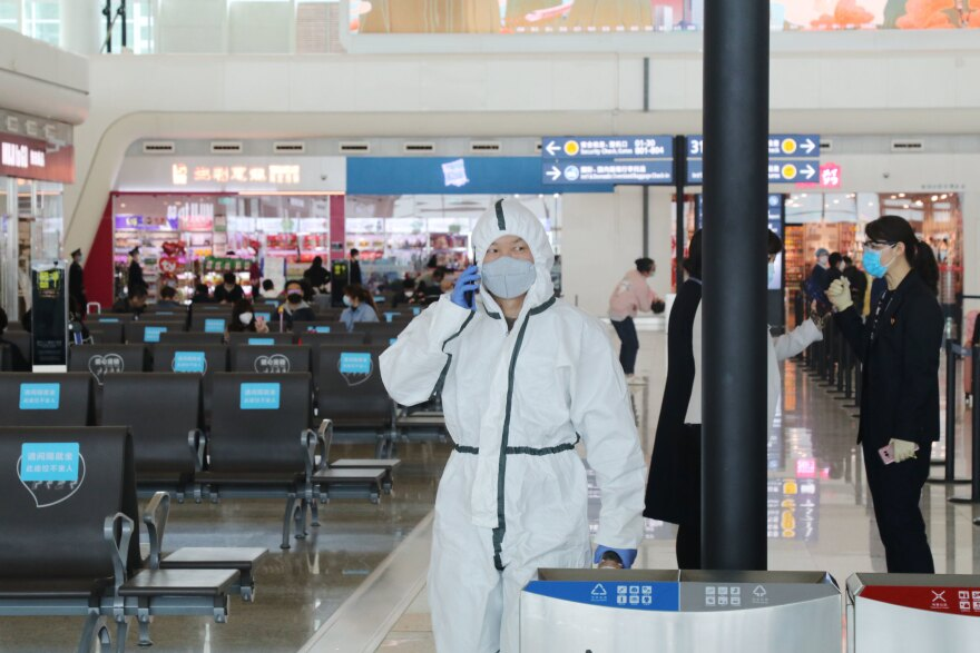 With rising concerns that the movements of asymptomatic carriers could lead to a second wave of infection, travelers remain vigilant about wearing protective gear at the Tianhe Airport in Wuhan.