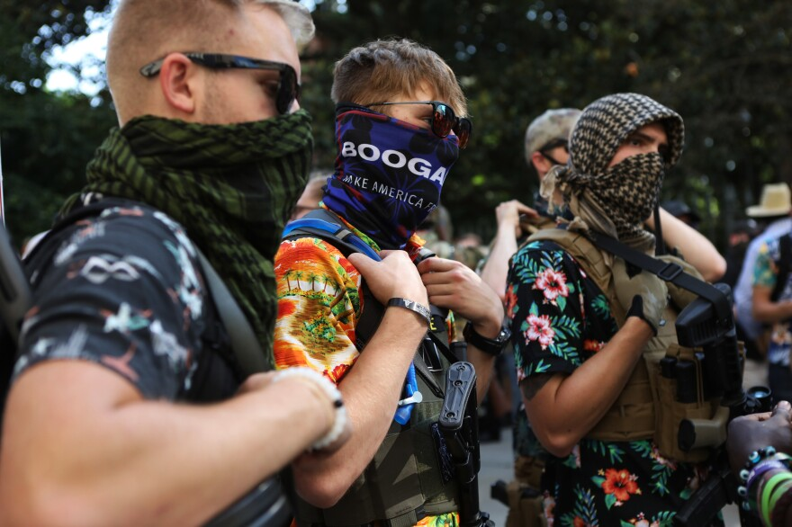 "Members of the Boogaloo movement carry semi-automatic firearms during a gun rights rally in Richmond, Va., on Saturday. The Hawaiian shirt-wearing so-called ""boogaloo boys"" are part of an amorphous movement of disenchanted, mostly white men who think another Civil War is inevitable, even necessary, to correct an overreaching federal government and other societal ills."